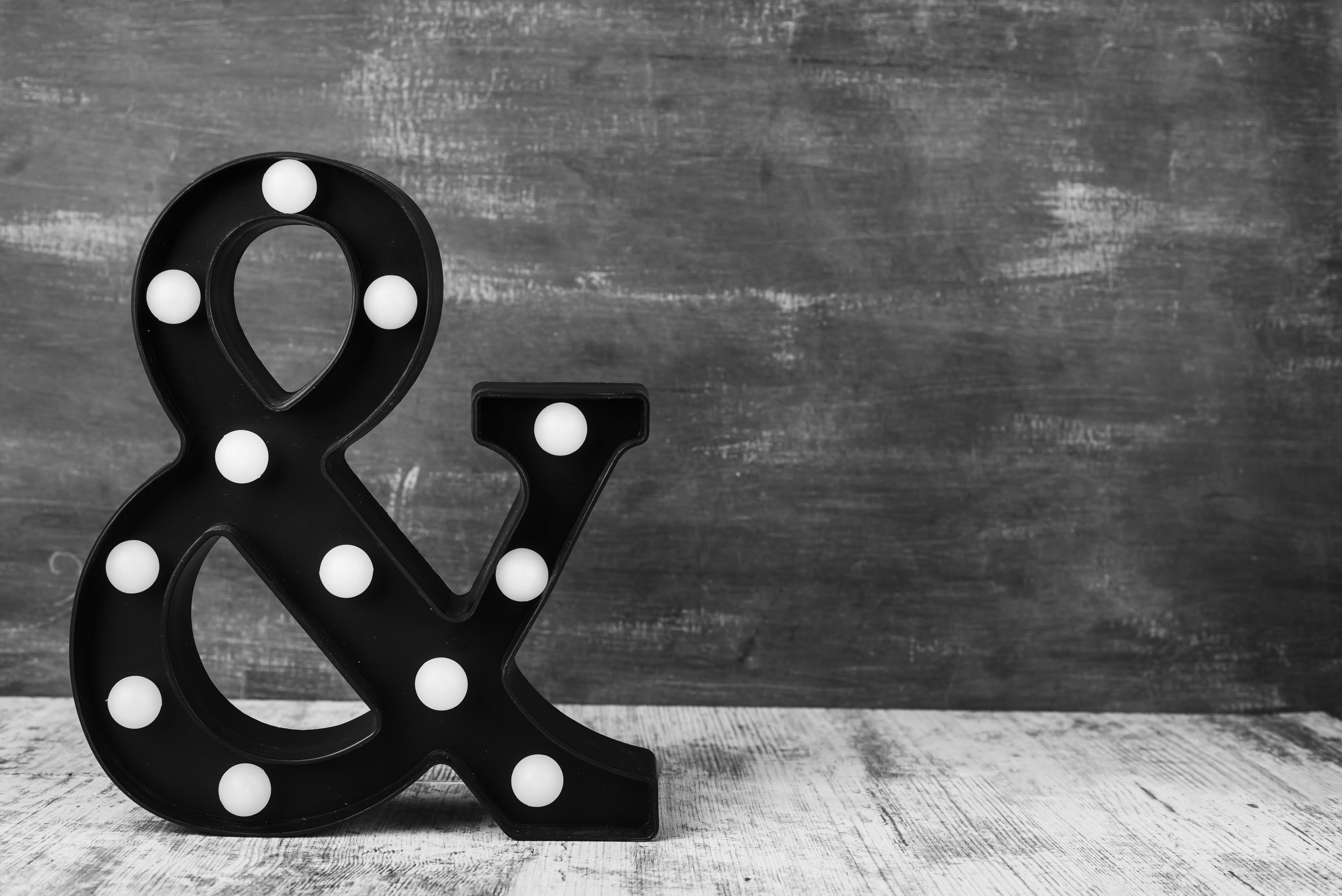 ampersand & sign on the background of a black board