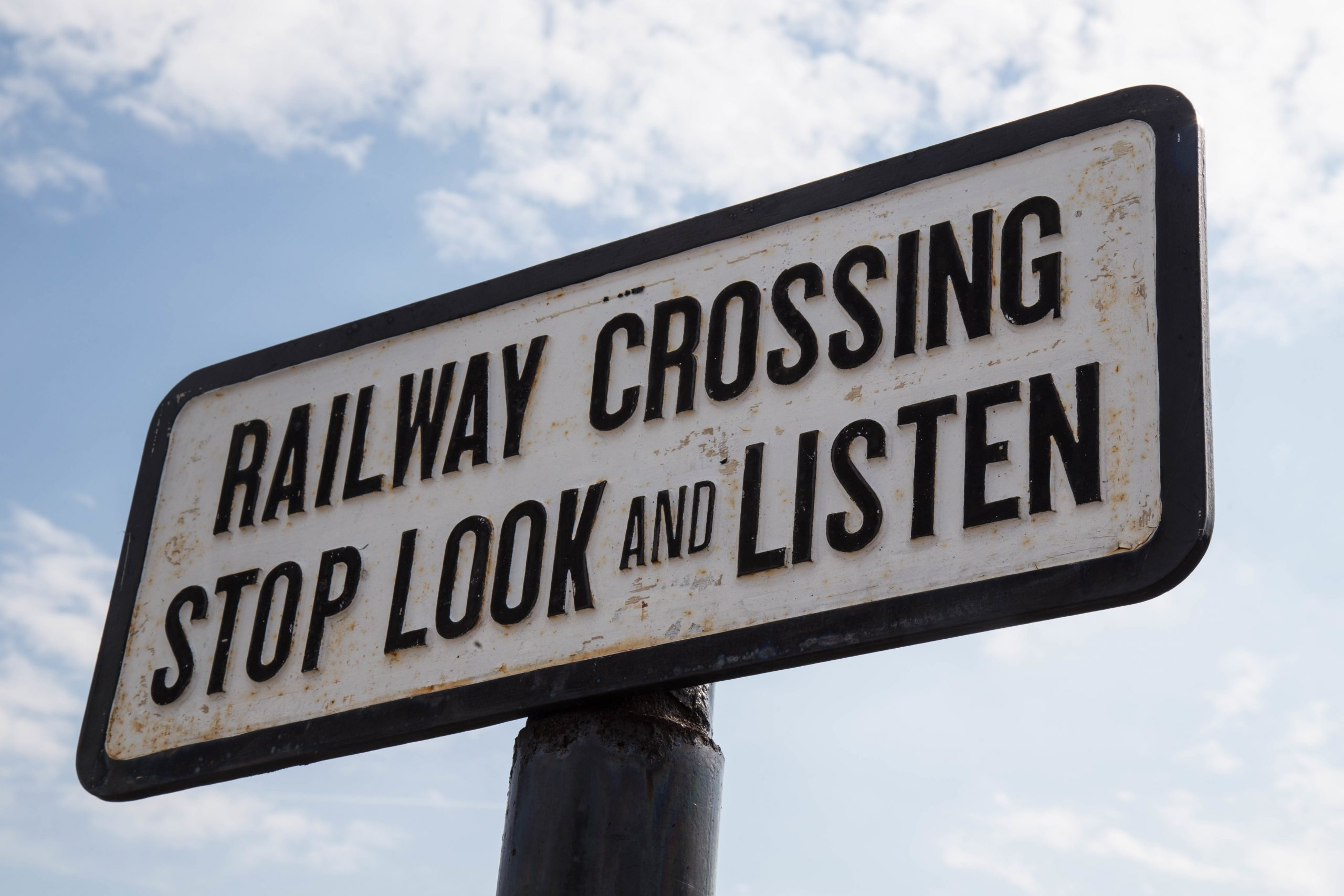 Stop look and Listen before crossing.